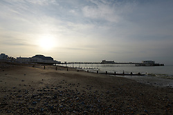 © Licensed to London News Pictures. 09/06/2014. Worthing, UK. Early morning sunlight over Worthing Pier. The sun rises over Worthing Pier on a calm morning where the forecast predicts rain and showers later in the day. Photo credit : Julie Edwards/LNP