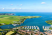 Nederland, Noord-Holland, Monnickendam, 13-06-2017; overzicht van Monnickendam met jachthaven aan de Gouwzee, IJsselmeer aan de horizon.<br /> Monnickendam with marina.<br /> <br /> luchtfoto (toeslag op standard tarieven);<br /> aerial photo (additional fee required);<br /> copyright foto/photo Siebe Swart