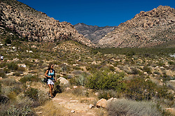 Woman hiking on Willow Springs Trail in Red Rock State Park near Las Vegas, Nevada, NV, woman hiker, model released, hiking, hiking path, image nv403-18445  .Photo copyright: Lee Foster, www.fostertravel.com, lee@fostertravel.com, 510-549-2202