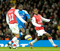 Photo: Ed Godden/Sportsbeat Images.<br /> Arsenal v Wigan Athletic. The Barclays Premiership. 11/02/2007. Wigan's Julius Aghahowa (centre), makes his way through the Arsenal defence.