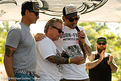 Event promoters Grant Peterson and Mike Davis give a special award to their friend Sonny Anderson on the main stat at their Born-Free Vintage Motorcycle show at Oak Canyon Ranch, Silverado, CA, USA. Sunday, June 23, 2019. Photography ©2019 Michael Lichter.