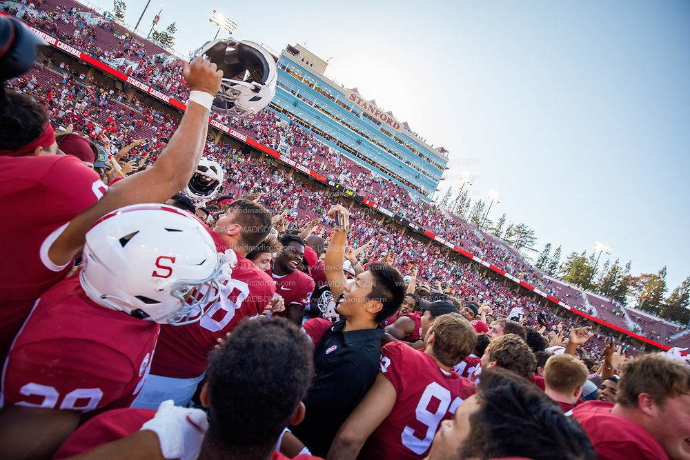 PALO ALTO, CA - OCTOBER 2:  Stanford Cardinal football players and fans celebrate on the field after the Stanford's 31-24 overtime victory over the Oregon Ducks in a Pac-12 college football game on October 2, 2021 at Stanford Stadium in Palo Alto, California.  (Photo by David Madison/Getty Images)