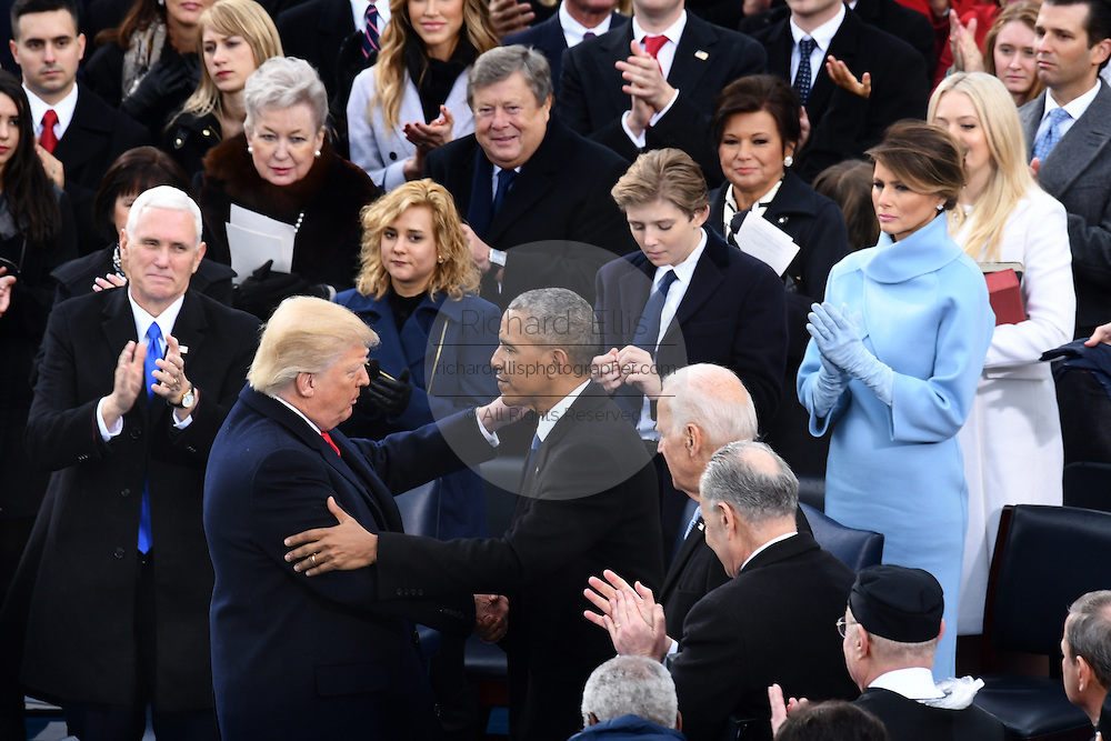 President Donald Trump thanks former President Barack Obama following being sworn-in as the 45th President on Capitol Hill January 20, 2017 in Washington, DC.