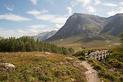 A woman hiking the lower part of devils staircase in the Glencoe Valley on the 30th August 2016 in Glencoe in the Scottish Highlands in the United Kingdom.