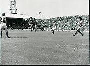 League of Ireland vs Liverpool FC.    (M87)..1979..18.08.1979..08.18.1979..18th August !979..In a pre season friendly the League of Ireland took on Liverpool FC at Dalymount Park Phibsborough,Dublin. The league team was made up of a selection of players from several League of Ireland clubs and was captained by the legendary John Giles. Liverpool won the game by 2 goals to nil..The scorers were Hansen and McDermott...Despite the attentions of the Irish defence Ray kennedy drives the ball towards the Irish goal.