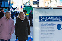 A handful of protesters demonstrate in Romford, East London against the trial use of a Met Police Facial Recognition system housed in a green van. London, February 14 2019.