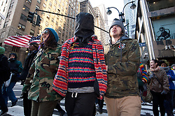 © licensed to London News Pictures. New York City, New York, USA. 3/01/12. Protestors perform 'mock detentions' during anti-NDAA march. Protests take place in manhattan against the recently passed National Defence Authorisation Act (NDAA), which protesters are concerned introduced indefinite detention powers to be used against those suspected of terrorism. Photo credit: Jules Mattsson/LNP
