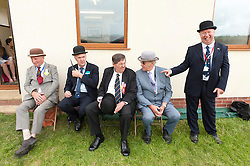 © Licensed to London News Pictures. 21/07/2015. Llanelwedd, UK. Stewards relax and joke in the Main Ring. The Royal Welsh Show is hailed as the largest & most prestigious event of it's kind in Europe. In excess of 200,000 visitors are expected this week over the four day show period - 2014 saw 237,694 visitors, 1,033 tradestands & a record 7,959 livestock exhibitors. The first ever show was at Aberystwyth in 1904 and attracted 442 livestock entries. Photo credit: Graham M. Lawrence/LNP