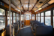 Interior of a venerable carriage of a Lisbon's nº28 yellow tram, at Martim Moniz square, on his way through the central, most historic region of the city.