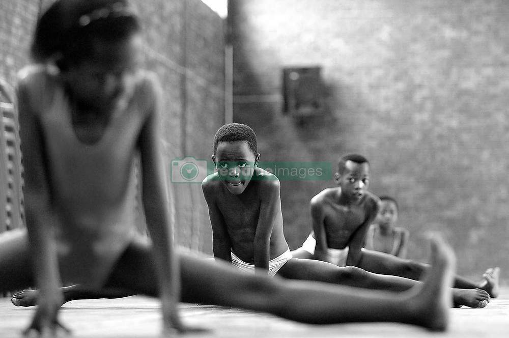 Nov 24, 2005 - Alexandra, Gauteng, South Africa - Ballet classes at the East Bank community hall in Alexandra Township just outside of Sandton in South Africa are run free of charge by Prima ballerina Penelope Thloloe, who works with the underprivileged children of Alexandra in the hope that ballet may be their ticket out of the township. PICTURED: Children take part in a ballet class at the East Bank community hall in Alexandra Township. (Credit Image: © Shayne Robinson/ZUMA Press)