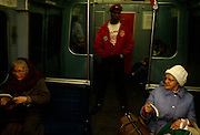 Volunteer Guardian Angels patrol the London underground in central London, an experiment in anti-crime in late-80s London. Patrolling the capital's transport system, an Angel stands over two elderly ladies in a dark-lit carriage. The Angels are under the supervision of the organisation's creator Curtis Sliwa, who started the band of youths to help make New York a safer place, - and in London's case in an era before CCTV made travel less secure. The Guardian Angels is a non-profit international volunteer organization of unarmed citizen crime patrollers. The Guardian Angels organization was founded February 13, 1979 in New York City by Curtis Sliwa and has chapters in 15 countries and 144 cities around the world. Sliwa originally created the organization to combat widespread violence and crime on the New York City Subways.