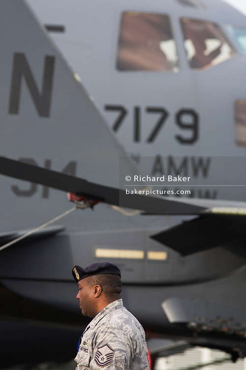 US Air Force Sergeant provides security while presenting military aircraft to the public at the Farnborough Airshow.