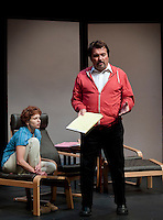 """Jim Rogato as Nick/Fireman recalls stories of his fellow firefighters who were lost on 9/11 while Katie Dunn as Joan/the Editor listens at the dress rehearsal of """"The Guys"""" at the Winnipesaukee Playhouse on Wednesday evening.  (Karen Bobotas/for the Laconia Daily Sun)"""