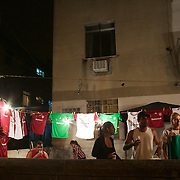 A football shirt seller touts for business outside the Olympic Stadium after the Fluminense V Corinthians, Futebol Brasileirao League match at the Olympic Stadium, Corinthians won the match 2-1. Rio de Janeiro. Brazil. 15th September 2010. Photo Tim Clayton