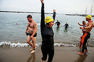 Nancy Jodaitis, an AB 540 financial aid counselor at SF State, celebrates after swimming to shore during the Alcatraz Invitational in San Francisco, Calif., Sunday, Sept. 13, 2015. Jodaitis participated in the event along with other  SF State faculty and community activists as part of a fundraiser for Continue the Dream for Academic Excellence Scholarship, a scholarship available to AB 540 and undocumented students at SF State that are not eligible for financial aid according to the university. (Joel Angel Juárez / Golden Gate Xpress)