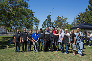 Nob Hill Foods employees pose for a group photo during a Nob Hill Foods farewell BBQ at Strickroth Park in Milpitas, California, on May 15, 2016. (Stan Olszewski/SOSKIphoto)