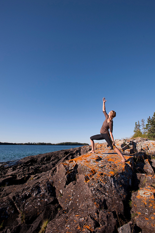 Practicing yoga on a rocky island in Lake Superior at Isle Royale National Park.