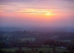 © Licensed to London News Pictures. 25/11/2014. Dorking, UK A view from Box Hill, Surrey today, 25th November 2014, as The sun struggles to break through low cloud and mist at sunrise over the South Downs. Photo credit : Stephen Simpson/LNP