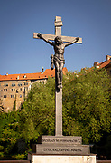 A statue of Jesus crucified on the cross. It is located on the Lazebnicky Most Bridge in Cesky Krumlov, Czech Republic.