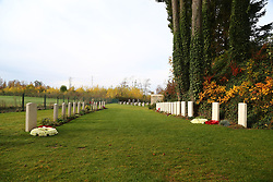 The wreaths placed by Prime Minister Theresa May and Belgian Prime Minister Charles Michel at the St Symphorien Military Cemetery in Mons, on the graves of John Parr (left), the first British soldier to be killed in 1914, and George Ellison (right), the last to be killed before Armistice.