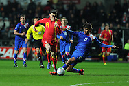 Gareth Bale of Wales is tackled by Croatia's Vedran Corluka.  FIFA World cup 2014 qualifier, group A , Wales v Croatia at the Liberty Stadium in Swansea, South Wales on Tuesday 26th March 2013. pic by Andrew Orchard, Andrew Orchard sports photography,
