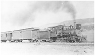 """RGS 2-8-0 #16 with passenger train, possibly near the site of the original roundhouse at MP 0.5.<br /> RGS  Ridgway, CO  ca. 1914<br /> In book """"Southern, The: A Narrow Gauge Odyssey"""" page 120<br /> See RD155-069 for original.<br /> Also in """"RGS Story Vol. I"""", p. 158.<br /> Thanks to Don Bergman for additional information."""