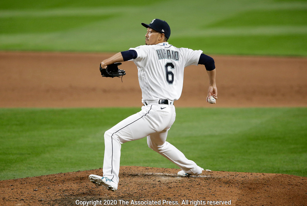Seattle Mariners' Yoshihisa Hirano wind up as he pitches against Texas Rangers during the ninth inning of a baseball game, Saturday, Aug. 22, 2020, in Seattle. The Mariners won 10-1. (AP Photo/John Froschauer)