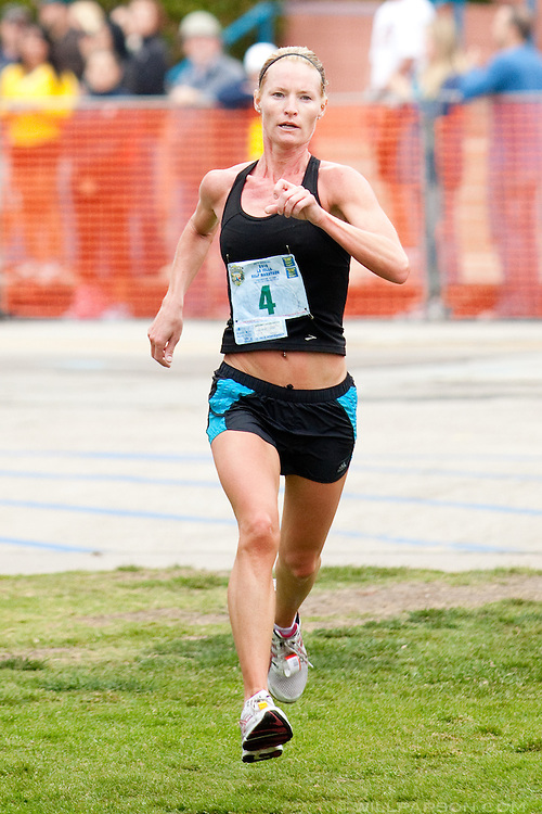 Jessica Goertz from San Diego crosses the finish line in first place in the women's division, and 20th overall during the La Jolla Half Marathon, April 25, 2010.