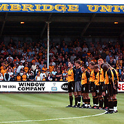 Cambridge United's players observe a minutes silence at the start of the match for Holly Wells and Jessica Chapman