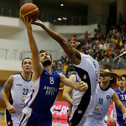 Istanbul BSB's Alexander Maurice (R) and Anadolu Efes's Birkan Batuk (L) during their Turkish Basketball League match Istanbul BSB between Anadolu Efes at Cebeci Arena in Istanbul Turkey on Monday 09 March 2015. Photo by Aykut AKICI/TURKPIX