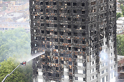 June 15, 2017 - London, United Kingdom - Firefighters continue to work at the scene the day after the Grenfell Tower fire in west London. (Credit Image: © Stephen Lock/i-Images via ZUMA Press)