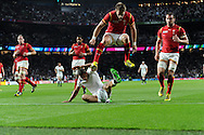 Jonny May of England scores his teams 1st try as the Wales players look on dejected. .  Rugby World Cup 2015 pool A match, England v Wales at Twickenham Stadium in London, England  on Saturday 26th September 2015.<br /> pic by  Andrew Orchard, Andrew Orchard sports photography.