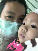 The girl who could come back from the dead: Toddler who died from a brain tumour is FROZEN by parents who hope she can one day be revived by medical advances<br /> <br /> A two-year-old girl who died from a brain tumour has been frozen - in the hope she will one day be revived by advances in science.<br /> Matheryn Naovaratpong, from Thailand, is thought to be the youngest person ever cryogenically preserved. <br /> The toddler was diagnosed with an aggressive form of cancer last April after she failed to wake up one morning, Motherboard's Brian Merchant reports<br /> After being admitted to a Bangkok hospital, tests revealed she had a 11cm tumour in the left side of her brain. <br /> <br /> Doctors diagnosed her with ependymoblastoma, a rare form of brain cancer that afflicts the very young.<br /> The outlook was bleak from the start - the disease has a five-year survival rate of 30 per cent.<br /> To make matters worse, Matheryn - known to her family as Einz - had fallen into a coma. <br /> After a months of intensive treatment, including 12 rounds of brain surgery, 20 chemotherapy treatments, and 20 radiation therapy sessions, it became clear there was little more doctors could do.<br /> She died on January 8th this year after her parents switched off her life support machine.<br /> By the time she passed away, she had lost 80 per cent of the left side of her brain - essentially paralysing the right side of her body. <br /> <br /> But determined for some good to come from her death, her family have had her body cryogenically preserved - by one of the biggest  providers of this service in the world.<br /> Matheryn is currently at the Arizona-based Alcor, her brain and body frozen separately at 196C.<br /> Her family's main - although many would argue, far fetched - hope is that one day, science will have progressed enough to restore life to her.<br /> Alternatively, her parents want the cells from her brain and other parts of her body to be saved, so the disease t