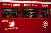 1990s commuters stare out the window of their red London Routemaster bus, operated by Leaside Buses, on 19th June 1994.  The bus is a traditional design called a Routemaster which has been in service on the capitals roads since 1954 and is nowadays only seen on heritage routes. From any angle, the bus is easily recognisable as that classic British transport icon.