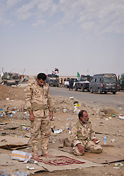 October 31, 2016 - Nineweh, Iraq - Iraqi army soldiers pray near to Mosul at the Tikrit road. The soldiers are preparing for the forthcoming operation. Approximately 50,000 Iraqi security forces personnel, Kurdish Peshmerga fighters, Sunni Arab tribesmen and Shia militiamen are involved in the two-week offensive to drive ISIS militants out of their last major urban stronghold in the country. (Credit Image: © Berci Feher via ZUMA Wire)