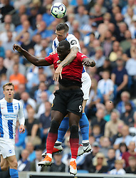 Brighton & Hove Albion's Shane Duffy (left) and Manchester United's Romelu Lukaku (right) battle for the ball in the air during the Premier League match at the AMEX Stadium, Brighton.