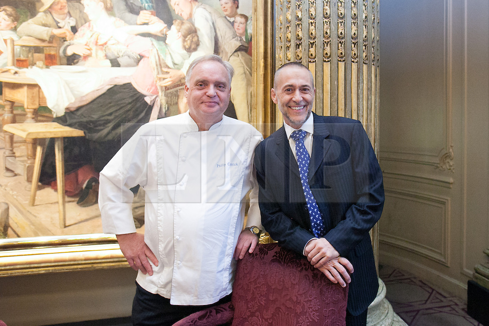 © London News Pictures. 20/09/2012. Chef Michel Roux Jr - La Gavroche and Chef Philip Corrick - The Royal Automobile Club relax before the fighting begins at Rumble in the Kitchen charity in support of Galvins Chance event in London.  Galvin's Chance charity supports young people aged 18-24 who may be ex-offenders or who are deemed disadvantaged, including those at risk of gang culture to find employment in the hospitality undustry.. Picture credit should read Manu Palomeque/LNP