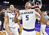 Players Berry Brown #5 and Justin Edwards #14 of the Kansas State Wildcats celebrate after defeating the number one ranked the Oklahoma Sooners 80-69 at Bramlage Coliseum in Manhattan, Kansas.