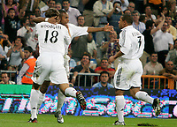 Real Madrid's Robinho is congratulated by teammates Jonathan Woodgate and Roberto Carlos after scoring hissides second goal during Spanish League game between Real Madrid and Athletico de Bilbao in Santiago Bernabeu stadium in Madrid, Spain, Thursday 22 September, 2005. (Photo / Alvaro Hernandez)