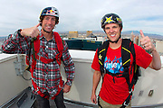 From left, Travis Pastrana and Erik Roner overlook the Las Vegas strip as they prepare for base jumping off The Signature at the MGM Grand Hotel & Casino on Wednesday June 1, 2011 in Las Vegas to promote the North American debut of Nitro Circus Live at the MGM Grand Garden Arena on Saturday June 4, 2011. (Jeff Bottari/AP Images for Nitro Circus Live)