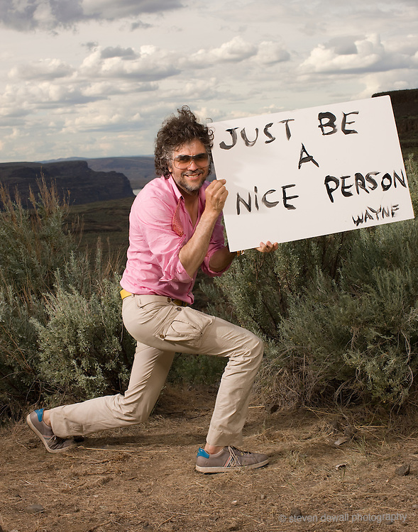 Wayne Coyne poses for a portrait backstage at the Sasquatch Music Festival. I had several artists pose with hand written protest posters for the protest issue of Under The Radar.