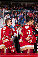 REGINA, SK - MAY 27: Mitchell Balmas #11, athletic therapist Melanie Landry, and Marc-André LeCouffe #42 of Acadie-Bathurst Titan stand on the bench during the national anthem Regina Pats at the Brandt Centre on May 27, 2018 in Regina, Canada. (Photo by Marissa Baecker/CHL Images)