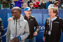 Elite runners meet and greet spectators at the finish line. Wesley Korir, Greg Meyer, Bill Rodgers