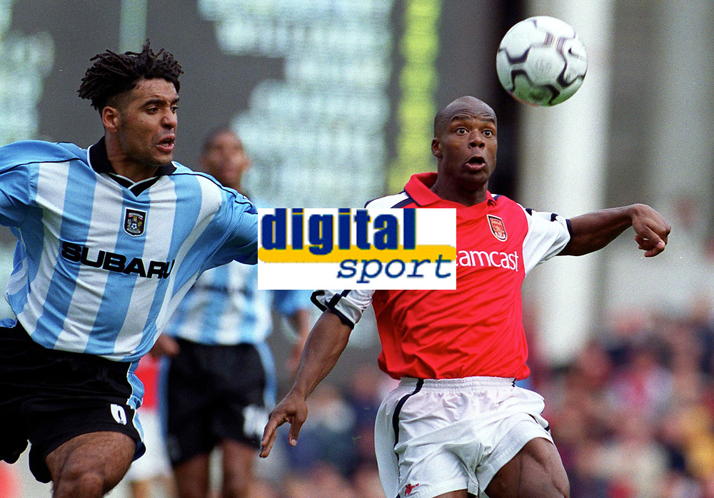 Sylvian Wiltord (Arsenal) Richard Shaw (Coventry City). Arsenal 2:1 Coventry City, F.A. Carling Premiership, 16/9/2000. Credit: Colorsport / Paul Roberts.