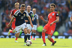 10th June 2017 - 2018 FIFA World Cup Qualifying (Group F) - Scotland v England - Dele Alli of England passes the ball beyond James McArthur of Scotland - Photo: Simon Stacpoole / Offside.