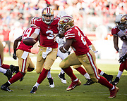 San Francisco 49ers quarterback C.J. Beathard (3) hands the ball off to San Francisco 49ers running back Carlos Hyde (28) against the Arizona Cardinals at Levi's Stadium in Santa Clara, Calif., on November 5, 2017. (Stan Olszewski/Special to S.F. Examiner)