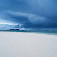 Scenic white sand beach with stormclouds overlooking Sound of Harris, Berneray, Outer Hebrides, Scotland