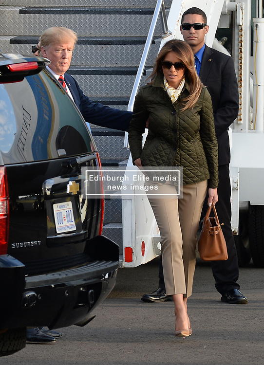 President of the United States of America Donald Trump touched down at Prestwick Airport in Scotland at the start of a three day break at his golf resort at Turnberry. The President, accompanied by First Lady Melania Trump, was greeted on his first visit to Scotland as US President by Scottish Secretary David Mundell.<br /> <br /> © Dave Johnston / EEm