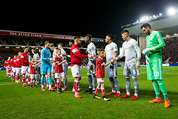 Mascot greets Marcos Rojo of Manchester United as Bailey Wright of Bristol City greets Anthony Martial of Manchester United - Rogan/JMP - 20/12/2017 - Ashton Gate Stadium - Bristol, England - Bristol City v Manchester United - Carabao Cup Quarter Final.