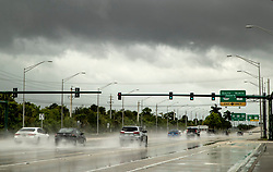 September 2, 2019, Wellington, Florida, USA: Traffic on Southern Boulevard as an outer band of clouds from Hurricane Dorian passes by on September 2, 2019. (Credit Image: © Allen Eyestone/The Palm Beach Post via ZUMA Wire)